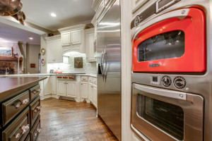 Home Remodeling - Updated kitchen with red microwave and red accents