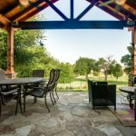 Suburban Outdoor Living Space with Stained Cedar and Flagstone Patio