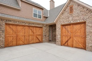 Upgrade Your Garage - Stained wood garage doors
