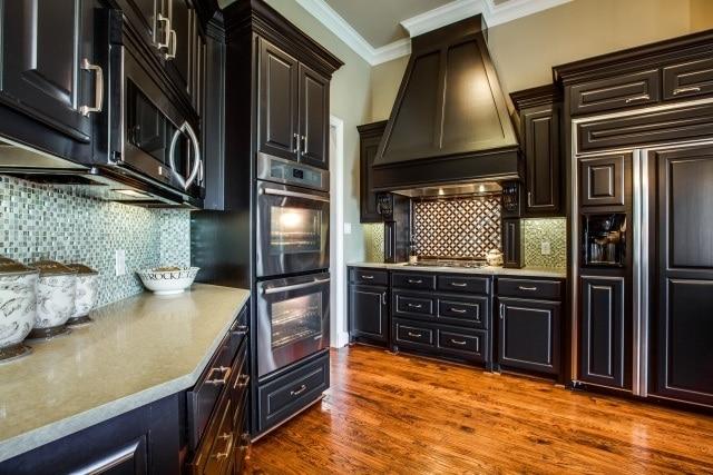 Remodeled Kitchen Details with Glass Tile Backsplash