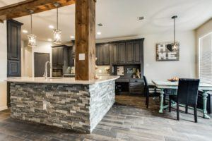 renovated kitchen with brick, stone and hardwood materials
