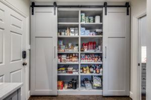 large kitchen pantry with sliding barn doors