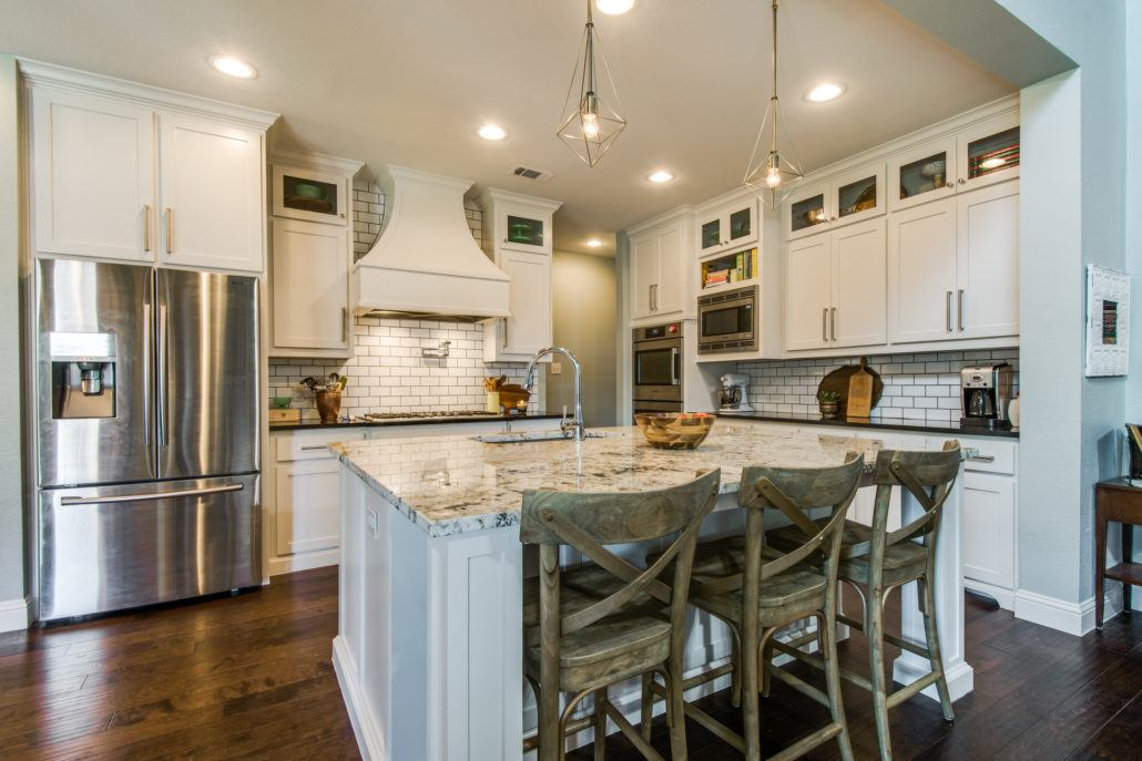 kitchen design trends - remodeled kitchen with white cabinets and subway tile backsplash