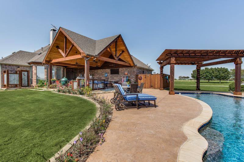 Outdoor Entertainment - outdoor living area with patio cover and pool seating