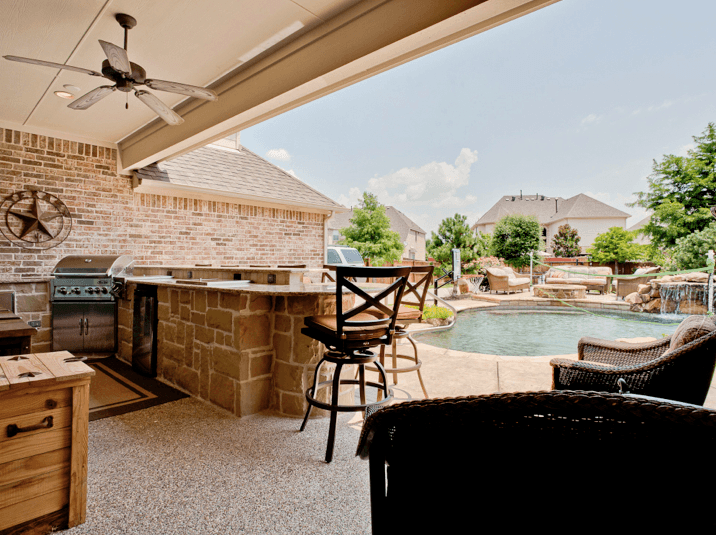 Outdoor Entertainment - outdoor living space with kitchen and pool
