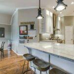 custom cabinets granite countertop hard wood floors open floorplan iron leg barstools eat at bar island