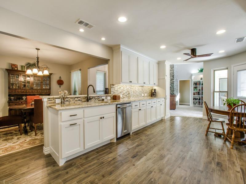faux wood tile, kitchen remodel, granite countertop, oil rubbed bronze hardware, stainless steel dishwasher, open floorplan