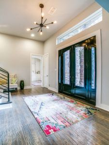 DFW Improved - Renovated Front Entryway with double doors and light fixture
