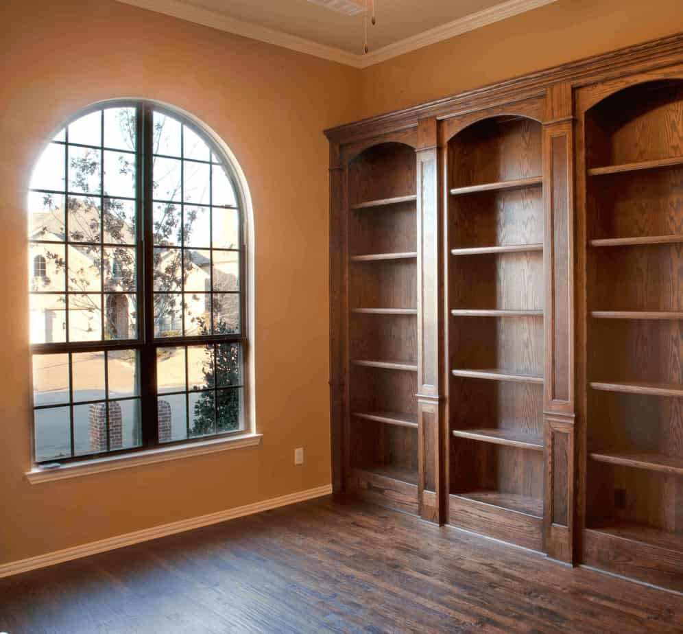 Wood built-in bookcase after insurance restoration