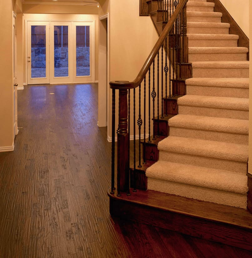 Wood floors and staircase after insurance restoration