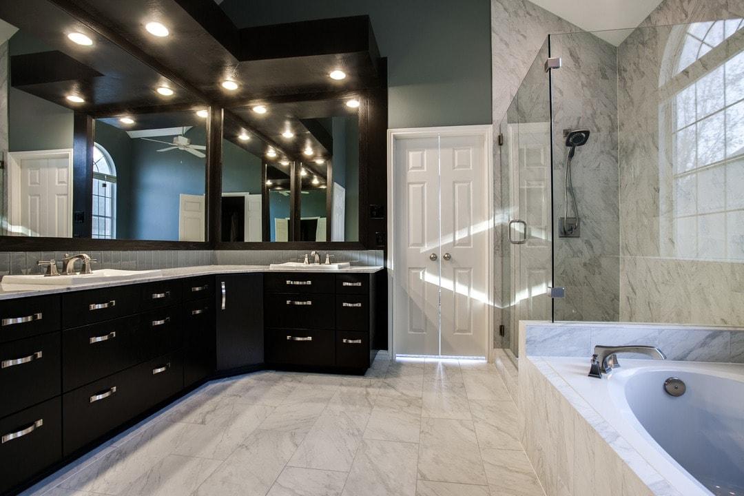 custom closet, custom cabinets, marble, frameless glass shower, lighting