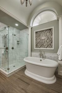 Bathroom Remodel - grey bathroom with glass shower and white tub
