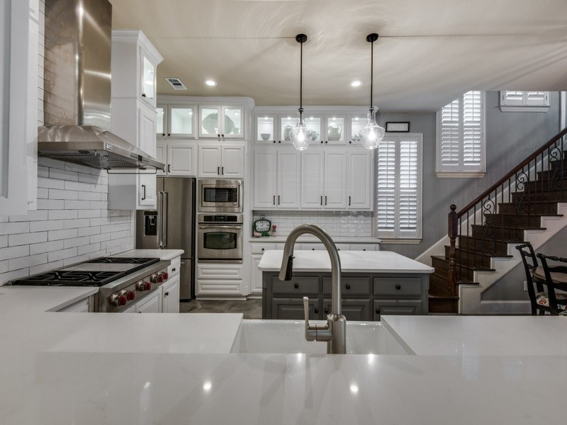 kitchen in lewisville texas including a kitchen bath family room and fireplace