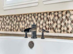Home Remodeling - Metal faucet fixtures in bath tub
