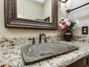 Home Remodeling - uniquely textured metal sink in bathroom