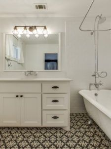 Home Remodeling - White bathroom with white and black statement tile flooring
