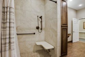 aging in place features - shower with seat and handle bars