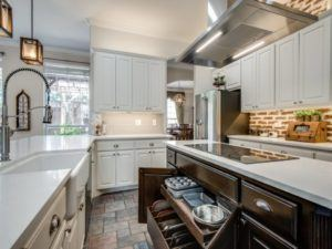kitchen features worth the investment - updated kitchen with pull out drawers and storage