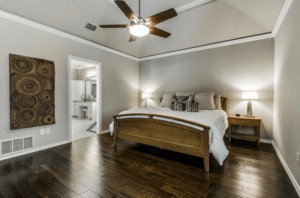 master bedroom design - neutral master bedroom with wood details