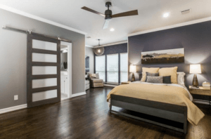 master bedroom - master bedroom with seating area and sliding barn door
