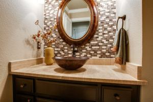 holiday hosting - updated powder bathroom with bronze features