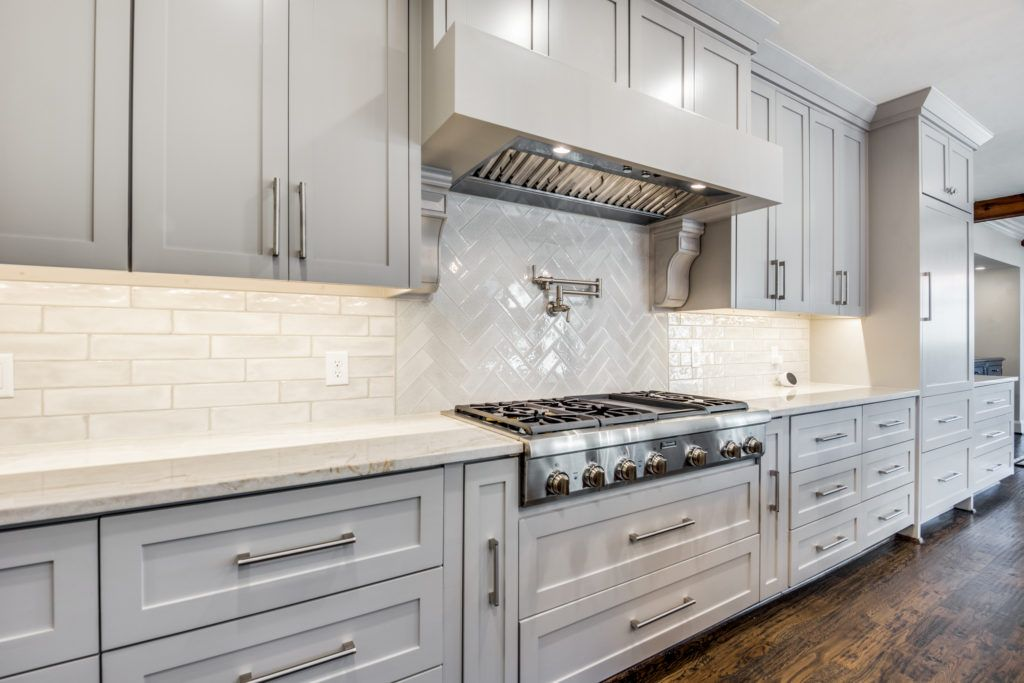 kitchen backsplash with white subway tile in a herringbone pattern