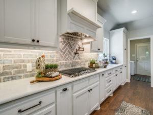 kitchen remodel - farmhouse kitchen with grey brick backsplash