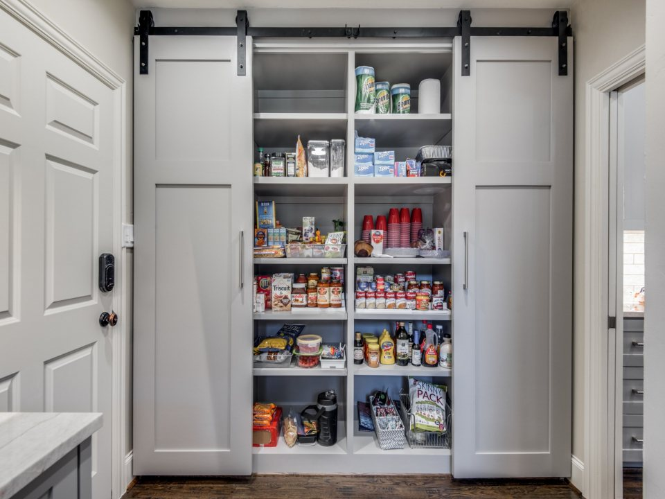kitchen design trends - remodeled kitchen with barn door pantry
