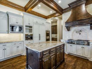 kitchen design trends - kitchen with wood ceiling beams and wood range hood