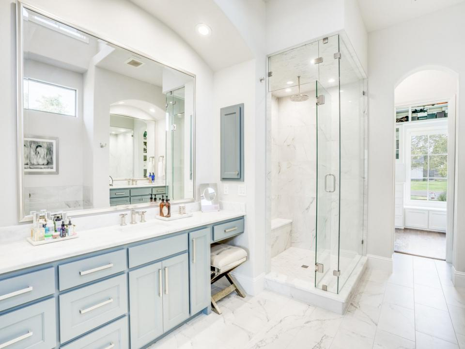 bathroom remodel - updated white bathroom with glass shower